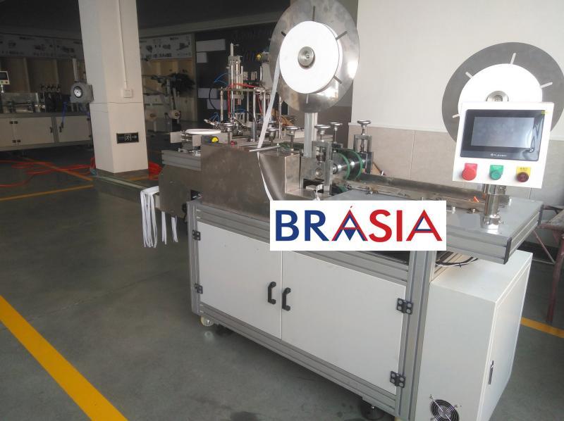 Máquina para Aplicar Tiras nas Máscaras Cirúrgicas de Tecidos não Tecidos (TNT)